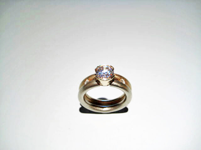 14K Y&W Gold Band with .40c Diamond and C.Z. Artist: Frank Ellman Catalog: 603-66-4 #19993 Price: $2,500.00 REDUCED: $900.00