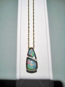 14K Gold Pendant and Chain with Opal and Diamond Artist: Kabana Stavros Catalog: 895-24-9 #19314 Price: $2,950.00 REDUCED: $1,500.00