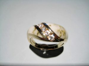 14K Gold Ring with Gold Quartz and .25c Diamond Artist: Kabana Stavros Catalog: 895-66-3 #19336 Price: $2,500.00 REDUCED: $1,200.00