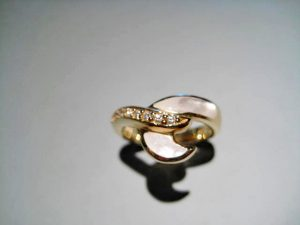 14K Gold Ring with White Mother of Pearl and .10c Diamond Artist: Kabana Stavros Catalog: 800-61-1 #19959 Price: $1,250.00 REDUCED: $700.00