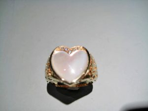 14K Gold Heart Ring with White Mother of Pearl and .07c Diamond Artist: Kabana Stavros Catalog: 900-57-4 Price: $1,950.00
