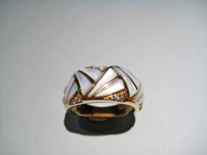 14K Gold Ring with White Mother of Pearl and .09c Diamond Artist: Kabana Stavros Catalog: 236-78-6 #18876 Price: $2,500.00 REDUCED $1,250.00