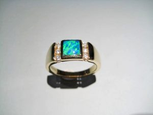 14K Gold Ring with Opal and .18c Diamond Artist: Kabana Stavros Catalog: 605-43-9 #18935 Price: $1,950.00 REDUCED: $1,100.00