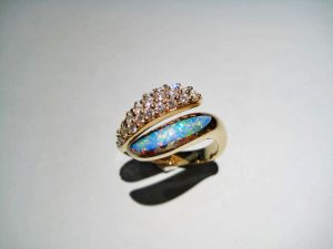 14K Gold Ring with Opal and Diamond Artist: Kabana Stavros Catalog: 800-41-8 #18920 Price: $2,950.00 REDUCED: $1,950.00