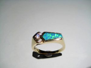 14K Gold Ring with Opal and Diamond Artist: Kabana Stavros Catalog: 583-04-8 #18881 Price: $1,950.00 REDUCED: $750.00