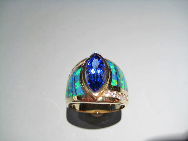 14K Gold Ring with Opal, Tanzanite, and .35c Diamond Artist: Kabana Stavros Catalog: 800-30-8 #18785 Price: $9,750.00 REDUCED: $4,950.00