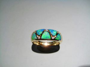 14K Gold Ring with Opal and .05c Diamond Artist: Kabana Stavros Catalog: 895-27-8
