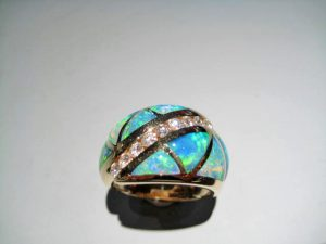 14K Gold Ring with Opal and .36c Diamond Artist: Kabana Stavros Catalog: 800-82-9 #18784 Price: $7,200.00 REDUCED: $3,500.00