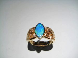 14K Gold Ring with Opal and .09c Diamond Artist: Kabana Stavros Catalog: 895-09-0 #18879 Price: $1,750.00 REDUCED: $995.00