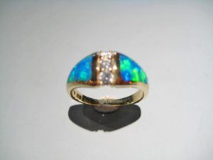 14K Gold Ring with Opal and Diamond Artist: Kabana Stavros Catalog: 800-40-3 #18882 Price: $2,950.00 REDUCED: $1,500.00