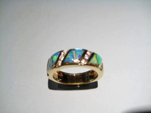 14K Gold Ring with Opal and .24c Diamond Artist: Kabana Stavros Catalog: 533-59-3 #1$3,500.00 REDUCED: $1,950.00