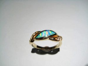14K Gold Ring with Opal and .11c Diamond Artist: Kabana Stavros Catalog: 895-26-5 #18936 Price: $1,650.00 REDUCED: $990.00