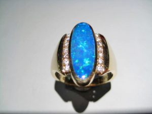 14K Gold Ring with Opal and Diamond Artist: Kabana Stavros Catalog: 800-47-5 #18758 Price: $4,400.00 REDUCED: $2,500.00