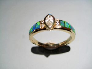 14K Gold Ring with Opal and .14c and .09c Diamond Artist: Kabana Stavros Catalog: 800-75-1 #19059 Price: $2,400.00 REDUCED: $990.00