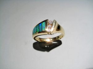 14K Gold Ring with Opal and .13c Diamond Artist: Kabana Stavros Catalog: 434-88-7 #19060 Price: $1,750.00 REDUCED: $990.00